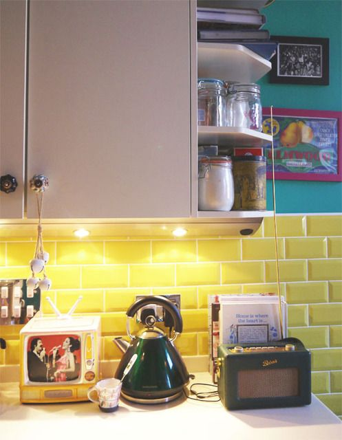 yellow subway tile looks awesome (this entire house is great with its use of color, wall paper and just fun decor) Image8_rect640