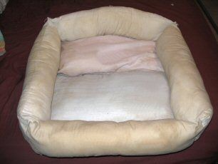 Make a pet bed out of old pillows. Dye it in the washer and let air dry.
