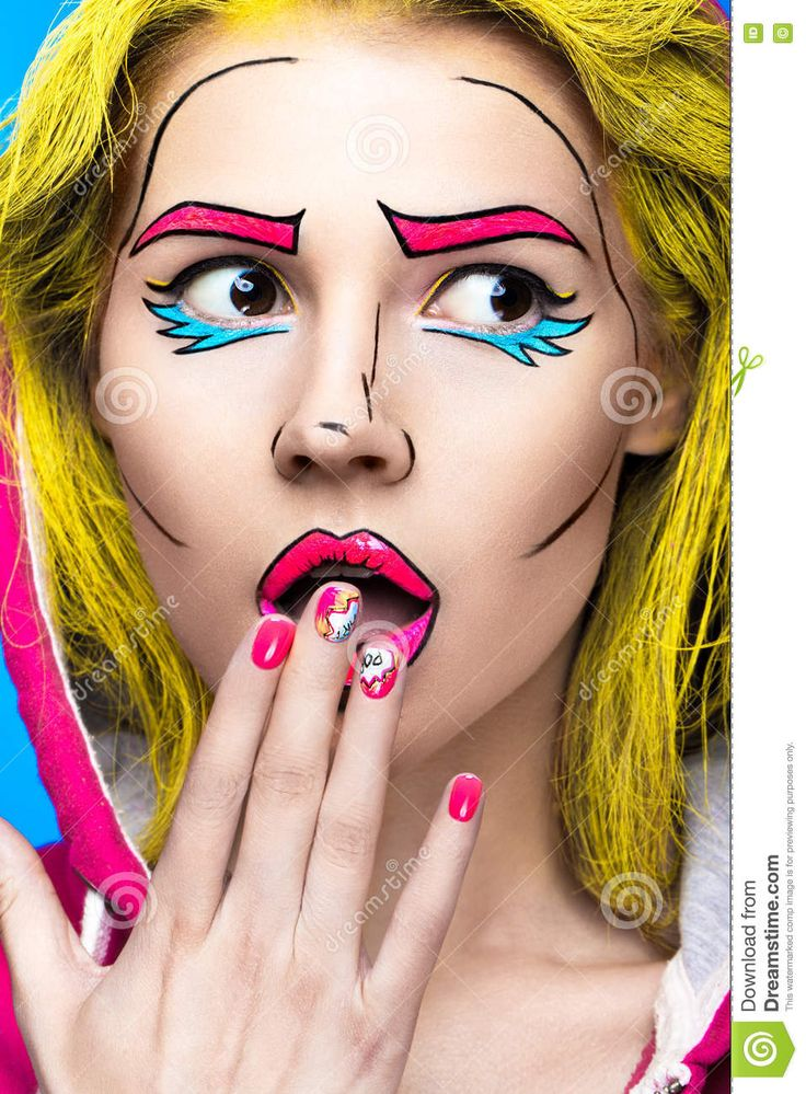 Photo of surprised young woman with professional comic pop art make-up and design manicure
