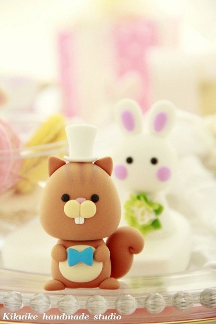 would be cute in clay~squirrel and rabbit cake toppers