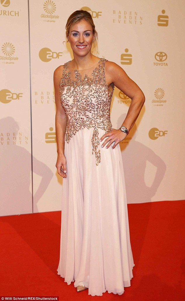 Glam: Dressed in a floor-length gown with glitzy sequin detailing she turned heads on the carpet