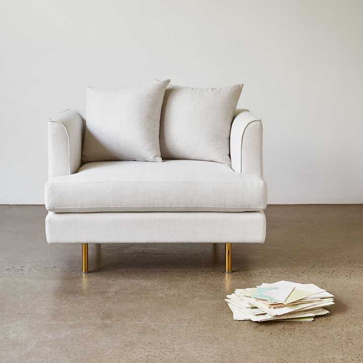 Margot Chair - Cambie Parchment | The Margot Chair epitomizes modern elegance with graceful arms, French-seam detailing, and loose, luxurious cushions to construct a look both contemporary and timeless. | Gus* Modern