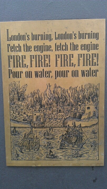 A memorial plaque of the Great Fire of London at the Monument.