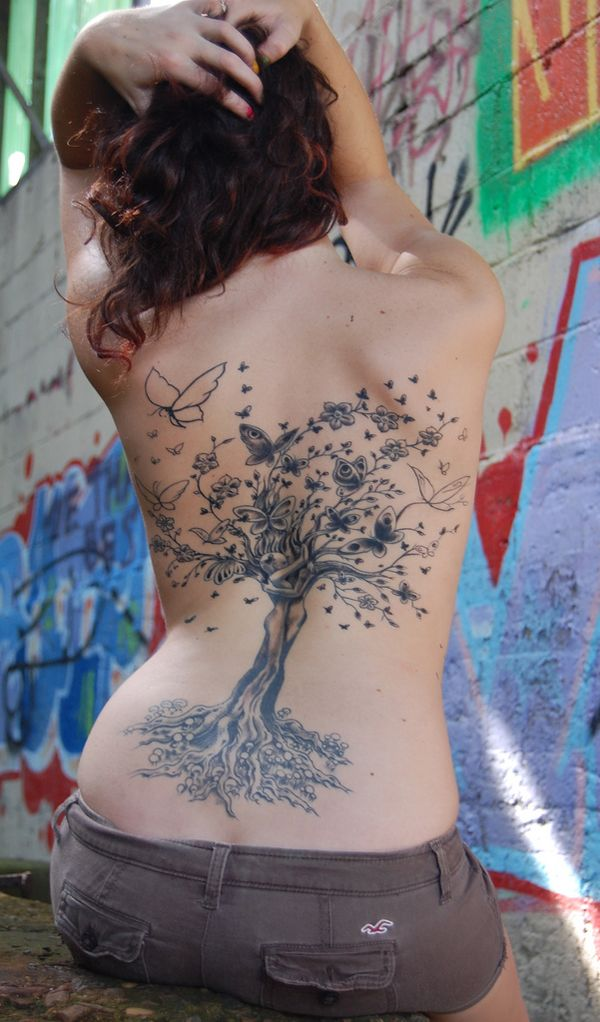 LOVE how the couple is incorporated from the roots up the tree. Some inspiration for my version...