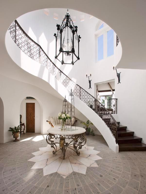 Dramatic Foyer Lighting : Dramatic star detail in marble with wrought iron