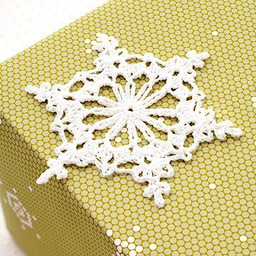 cut out a snowflake to pop on top of gifts for that extra christmassy look x