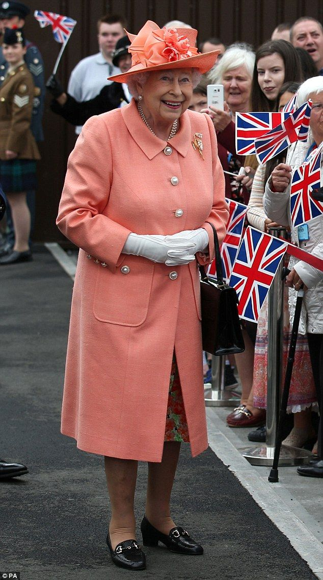 Dressed in a bright tangerine number, the Queen greets members of the public as she visits the new Highland Spring factory building in Blackford near Stirling on Thursday