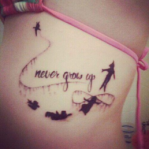 Never grow up Peter Pan infinity ribs tattoo