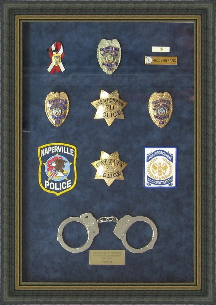 Badges Patches And Pins Beautifully Framed In A Shadow