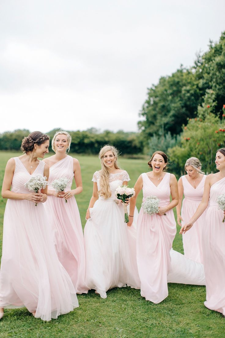 Bride Melanie wears the 'fleur' gown by Naomi Neoh for her Cripps Barn wedding. Her bridesmaids are most pretty in soft pink by 'For Her & For Him'. Images by M&J Photography.