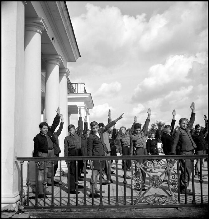 POLAND. Otwock. 1948. Tubercular children exercise on the terrace of Zofiowka sanatorium. ~ David Seymour