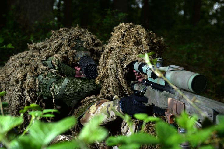 Airborne snipers take aim at Stanford Training Area (STANTA) in Norfolk. Photographer Corporal Andy Reddy; Crown copyright.