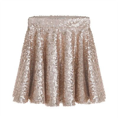 Sequin Skirt. A stunning circular skirt in matte effect gold sequins that every girl will want to wear. Combine with Sequin Vest to create a resplendent look for special occasions. Outer: 80% Polyester, 20% Viscose. Lining: 96% Polyester, 4% Elastane. Gentle Dry Clean only