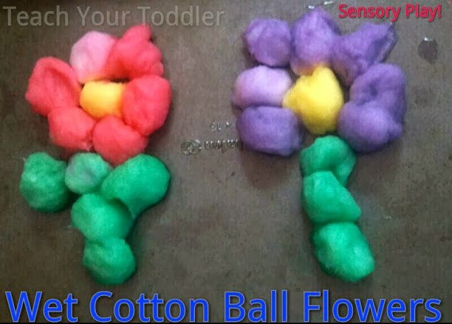 Teach Your Toddler: Wet Cotton Ball Flowers Sensory Play. Perfect for Spring. Toddlers love water play.