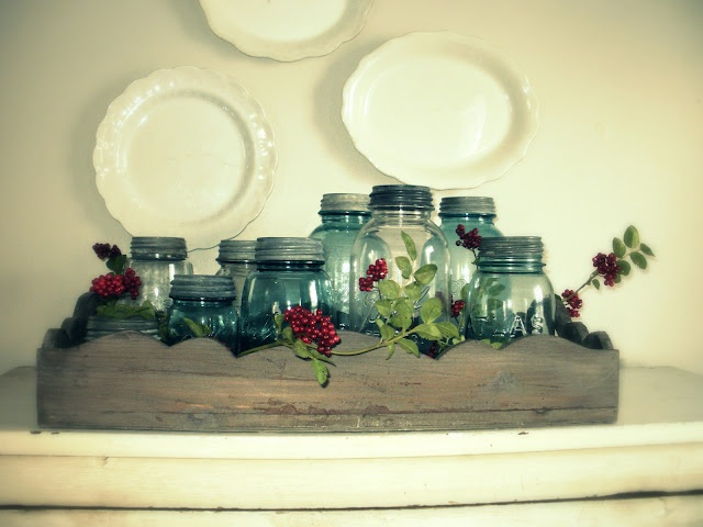 Love this, green jars with lids, different heights and sizes in wooden box.