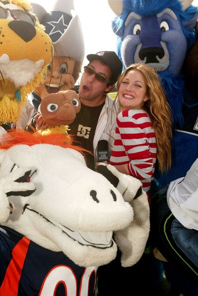 Adam Sandler and Drew Barrymore with some mascots