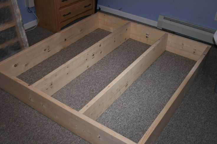 screw leg posts on inside corners and cover top with board before putting mattress on