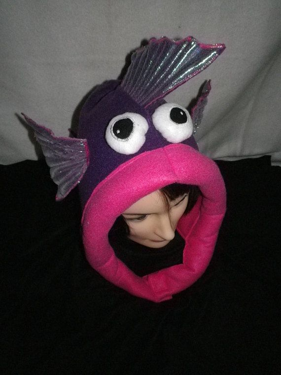 Fairytrades famous Fish Hats are Back! They come in a variety of colours and are stretchy so one size fits most. velcro fastenings for safety and cosiness. Adult and child size available. Great for festivals, fancy dress or just for fun.