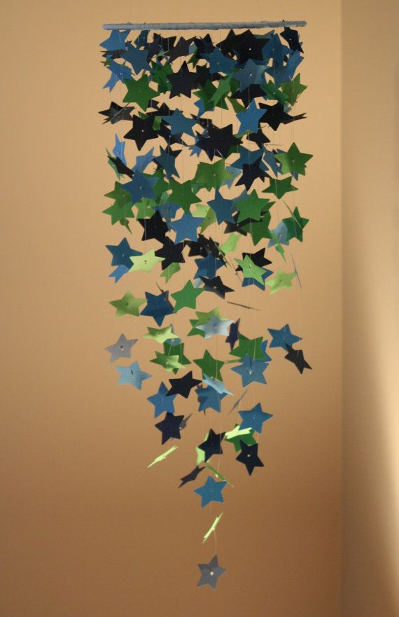 I bought this custom mobile for my son's nursery; love it! Star Mobile Blue Green Mobile Star Chandelier by OliviaOliverBaby
