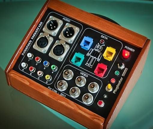 "Erik sez, ""Here's a Christmas toy I made for my toddler son. It is a custom patch panel, wiring, and button pushing toy created in the 'maker' tradition! I am a broadcast en…"