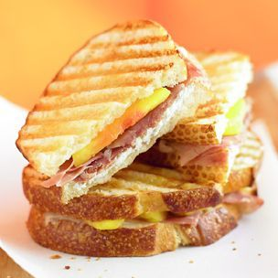 Prosciutto, Goat Cheese, & Peach Panini (Williams Sonoma)- Ingredients:  1 firm-ripe peach, peeled if desired, pitted and  cut into 1⁄4-inch slices  2 slices sweet batard, each 1⁄2 inch thick  1 Tbs. unsalted butter, melted  2 tsp. apricot preserves  2 Tbs. crumbled goat cheese (chèvre)  2 thin slices prosciutto. Serves 1.