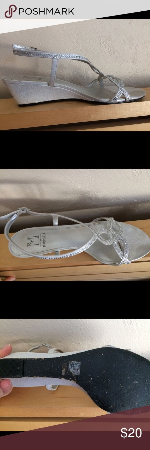 Size 8 silver dress shoe wedge Very cute silver wedge dress shoe with rhinestone accents. Worn for a few hours at a wedding. The bottoms took quite a beating from walking all over gravel, but they otherwise are in pretty good condition. Shoes Heels