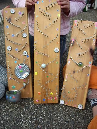 "Sound marble run - we used a good finished pine 1 x 8"" x 2' and they worked great - the nails make a nice tinkle with different size marbles - Summer Fun for kids at Grams Camp"