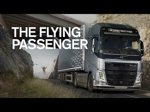 A Volvo FH 540 truck tows a paraglider through a tunnel in the world's first precision stunt featuring a truck and a paraglider.