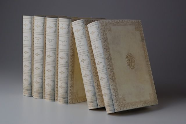 printed book jackets made to look like antique vellum books. Available in a variety of colors and spine designs. Customers may ship us their books to have new jackets put on or we can supply the books