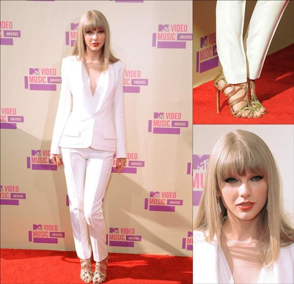 The 2012 MTV Video Music Awards   Taylor Swift All White J. Mendal pantsuit did nothing for her. The pantsuit is nice, but she chose the wrong hair style for this look. I love the Tom Ford sandals though