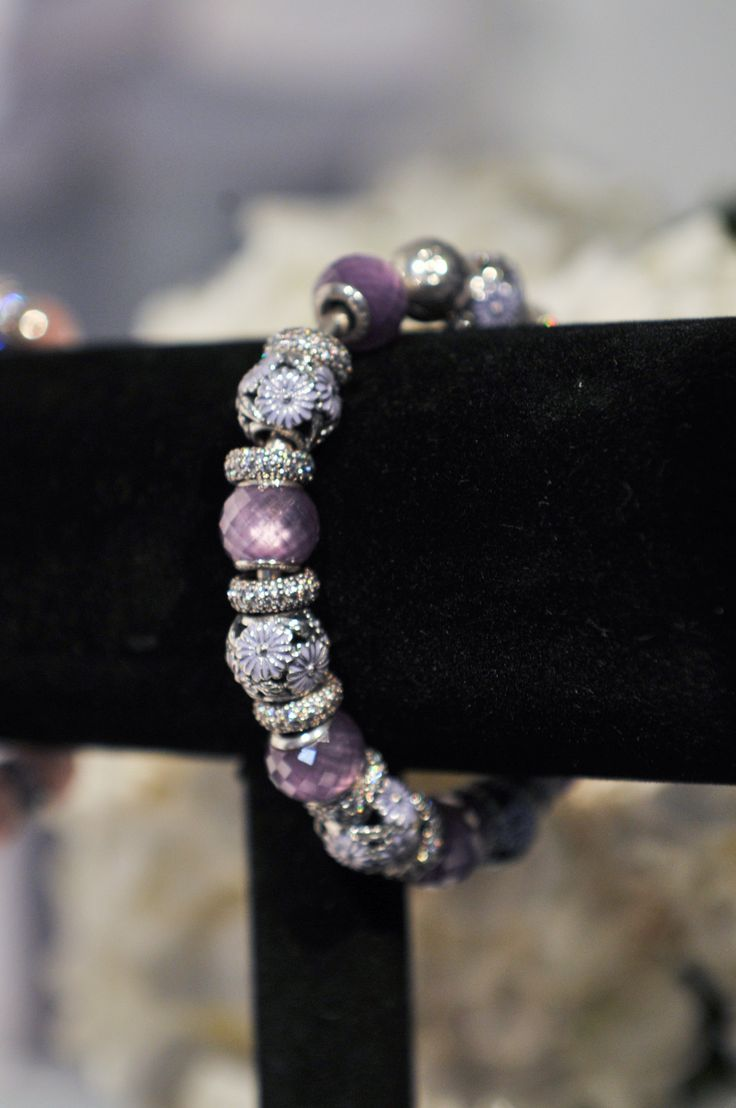 PANDORA bracelet styled with Lavender Daisy Meadow and Purple Petite Facets charms from the Spring collection 2015. #PANDORAbracelet