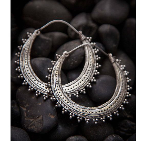One of our most loved designs, 92.5 silver Afghani style hoop earrings carved with dots and lines and ornamented with tiny brass balls on the rims.  Sold as Pair.  Please click here to get to know us better: https://www.etsy.com/uk/shop/Tribulondon?ref=hdr_shop_menu#about  And click here to view our policies and shipping information: https://www.etsy.com/uk/shop/Tribulondon?ref=hdr_shop_menu#policies  If you like the item please clic...