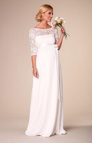 Schlicht und elegant mit auffälliger Blumenspitze. Unser Kleid Lucia ist wahrer Hingucker.