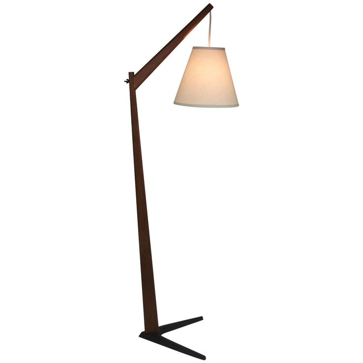 1960s Teak Floor Lamp with Boomerang Cast Iron Base, Made In Denmark | From a unique collection of antique and modern floor lamps  at https://www.1stdibs.com/furniture/lighting/floor-lamps/