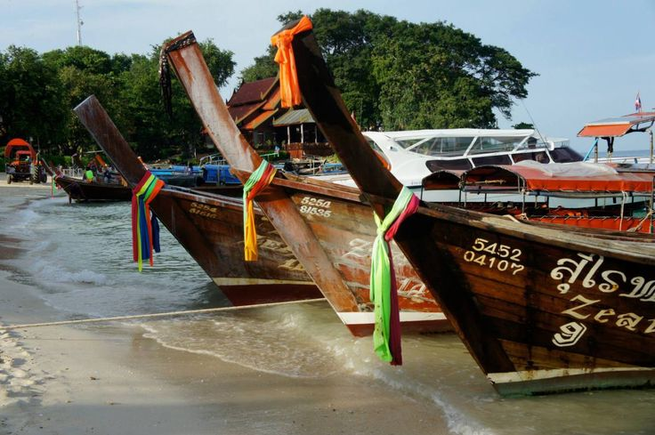 Long boats on Koh Phi Phi beach in Thailand
