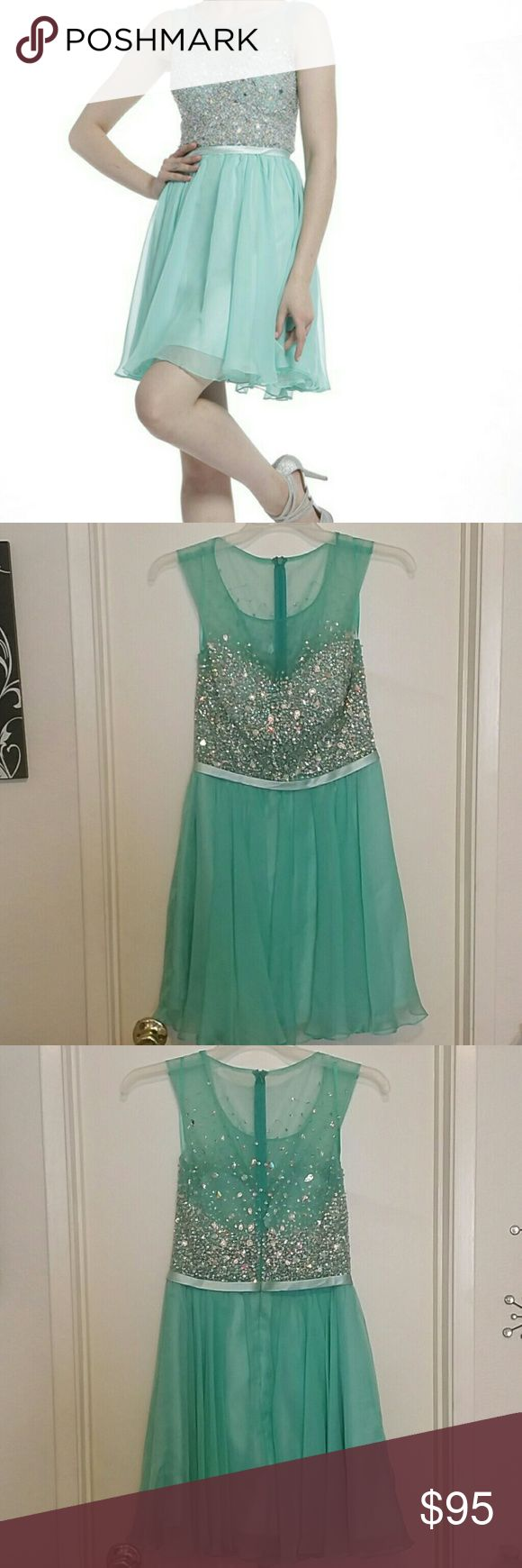 Mint formal dress Short mint dress with rhinestones. Wore once as a bridesmaid dress can also be used for prom or any special occasion. In perfect condition! Includes scarf! Please see images for waist and skirt measurements! Cinderella Divine Dresses Prom