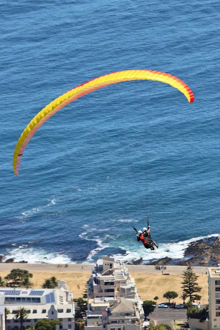 Paragliding Signal Hill Cape Town - one of the best things to do in Cape Town. You get a beautiful view Signal Hill, Lions Head, Table Mountain, and the ocean // localadventurer.com