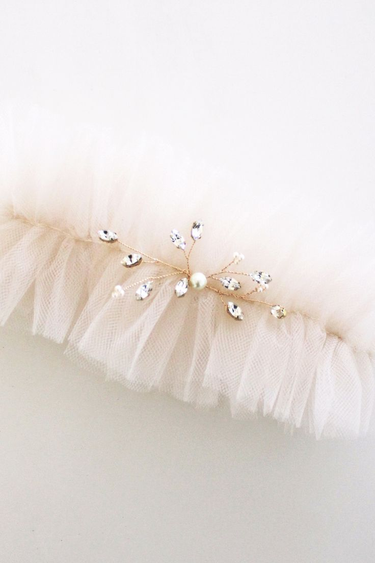 A blush ruffled tulle garter with rhinestone embellishment. Please leave a note with your measurements to have a perfect fit. 100% Handmade If you would like to customize this piece in a different color, or size please email info@handmadebysarakim.com. Please check our store policy for processing time and current order status. If you need your order shipped before our standard processing time, please contact us for more details.