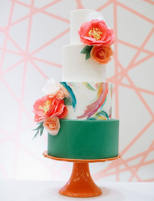This colorful cake with beautiful brushstrokes is the perfect combination of modern and classic with beautiful saturated colors and stunning florals.