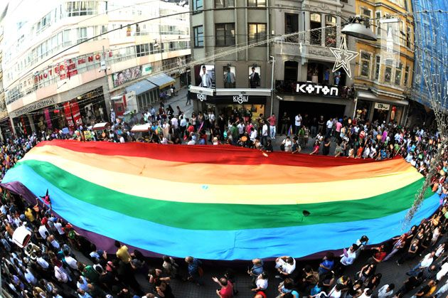 Istanbul, Turkey: Turkish homosexuals and human rights activists chant slogans as they hold a giant rainbow flag during the Gay Pride Parade march on Istiklal Avenue in Istanbul, on June 27, 2010.