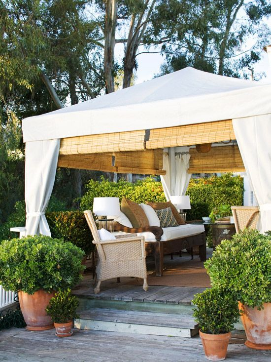 Beach Getaway  Blend into Your Surroundings  Weather-resistant fabric panels provide a romantic backdrop to this outdoor room, hiding the tent's structure and giving the space an intimate, enclosed feel. An assortment of potted plants blends the room with the yard.