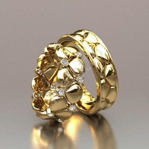 Эксклюзивные обручальные кольца из желтого и белого золота  85500 руб.