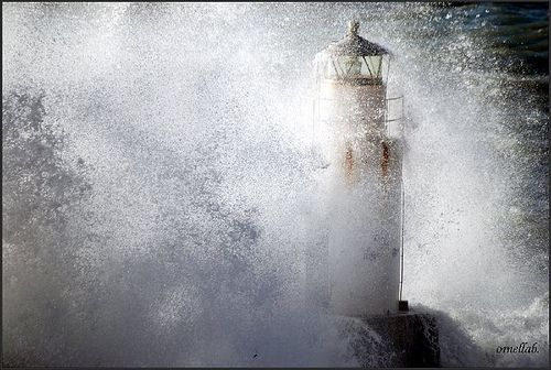 Lighthouse in the stormy sea by ornellab., via Flickr