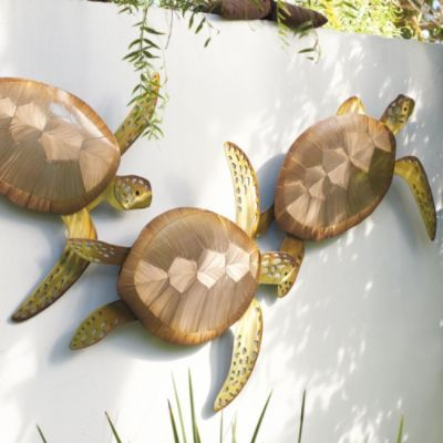 Sea Turtle Trio Wall Decor |   -- So charming for the outdoor walls!  Creates such a serene feel.  I love the different angles sculpted on their backs.  Would play with the sunlight beautifully!