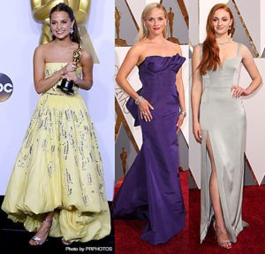 Alicia Vikander in a custom yellow Louis Vuitton dress, Reese Witherspoon in Oscar de la Renta and Tiffany & Co. jewelry and Sophie Turner in Galvan and Tiffany & Co. jewelry