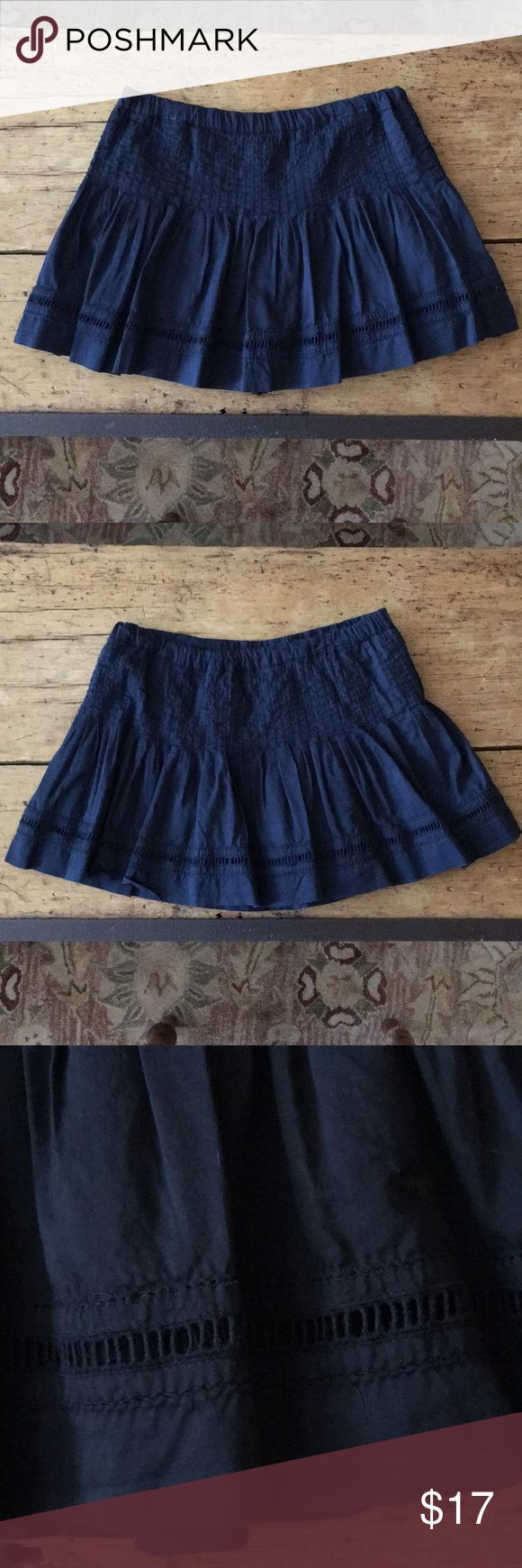 Very Cute Abercrombie Navy Skirt. Very cute mini skirt that fits really nicely around the hips because of all of the pleating and flairs at the bottom. Great cut out detail on the bottom too!  Elasticized waist band for even more comfort!  Pull on over your bikini bottom and go anywhere!  It's in excellent condition. Abercrombie & Fitch Skirts Mini