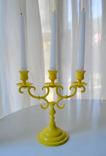 Spray paint old candleholders, color in pic is Sun Yellow from Rustoleum.   http://www.younghouselove.com/2010/09/jack-be-nimble/