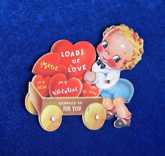 Adorable 1930's toy wagon full of hearts valentine die cut card. This little boy's head moves back and forth. In excellent condition.