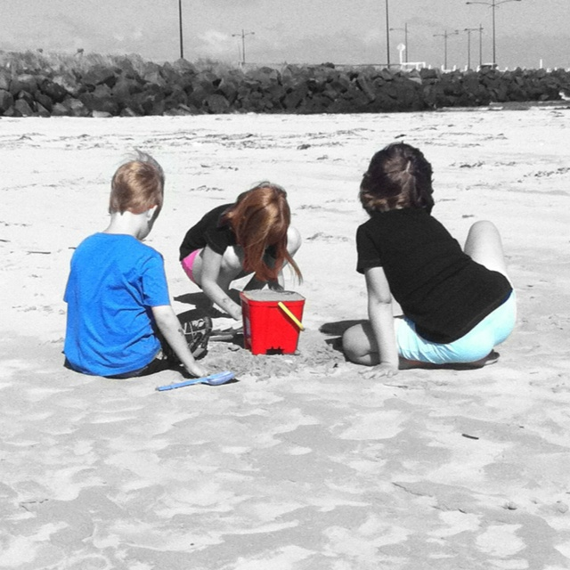 Kids at play on the beach. iPhoneography. Colour Splash.