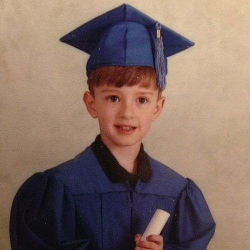 Justin Timberlake in a pointy hat with his diploma from bovine university